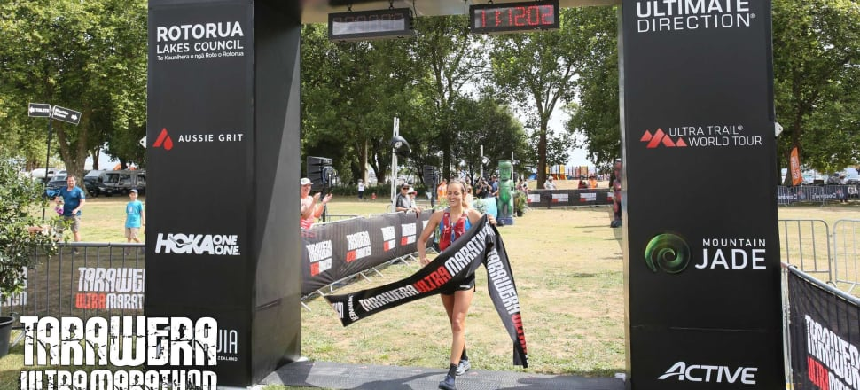 Caitlin Fielder crosses the finish-line to win the women's 50km race by over 27 minutes at the Tarawera Ultramarathon in her home town, Rotorua. Photo: Finisherpix.com.