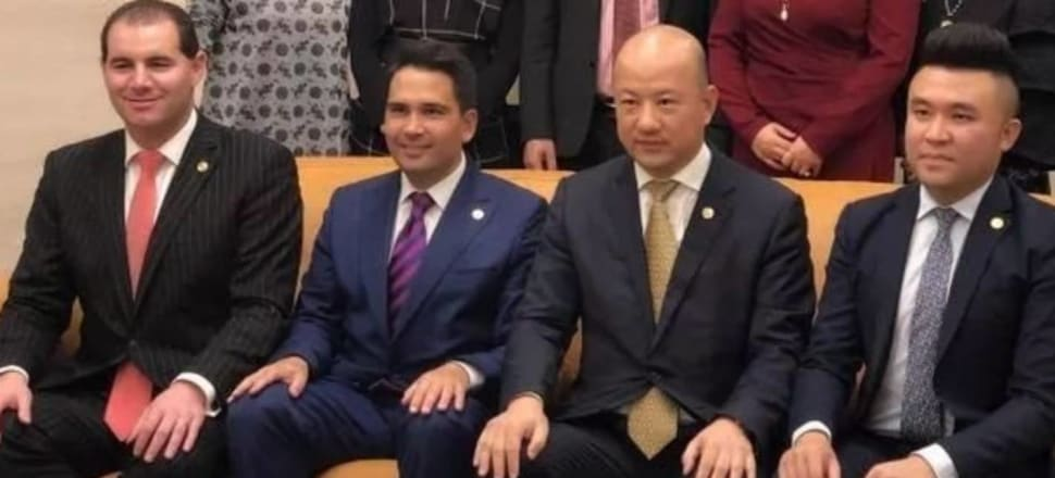 Jami-Lee Ross and Simon Bridges, who is not facing charges, with Zhang Yikun (second from right). Photo: WeChat