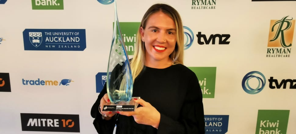 "Warriors community relations coordinator Georgia Hale, with her Young New Zealander of the Year Award, says she'll ""just keep doing what I'm doing, because it doesn't feel at all like work to me"". Photo: Mark Jennings."