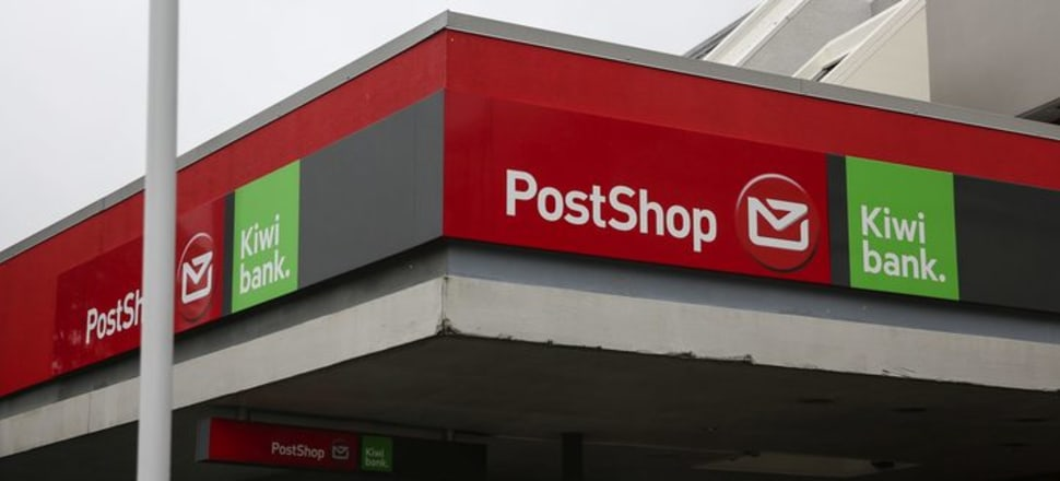 A Kiwibank and Post Shop sign. Photo: RNZ / Richard Tindiller