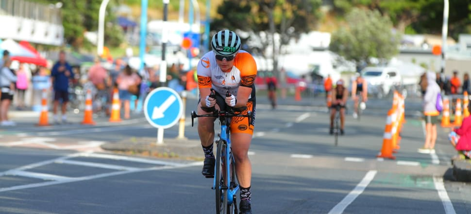 Wellington paramedic Laura Robertson, on the cycling leg of the Mt Maunganui Enduro race, became curious about multisport events after treating a triathlete who'd fallen off a bike. Photo: supplied.