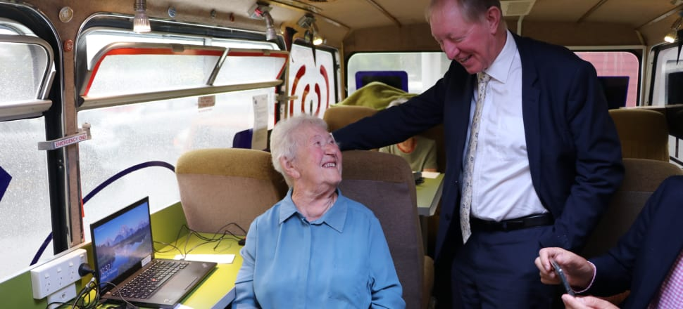 Roya De Lorenzo with MP Nick Smith onboard DORA. De Lorenzo has been learning how to use internet banking ahead of the demise of the cheque. Photo: James Murray, Nelson City Council
