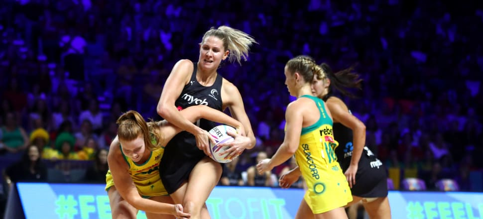 Casey Kopua rips the ball away from Australian Diamond Stephanie Wood in the final of the 2019 Netball World Cup in Liverpool. Photo: Getty Images.