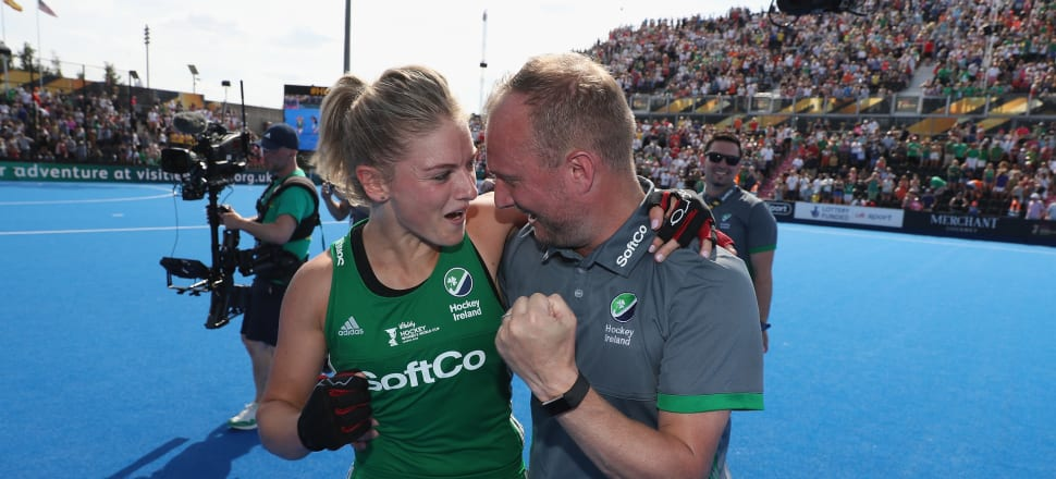 Graham Shaw celebrates with player Chloe Watkins after the Irish women stunned Spain in their semifinal at the 2018 World Cup.  Photo: Getty Images.