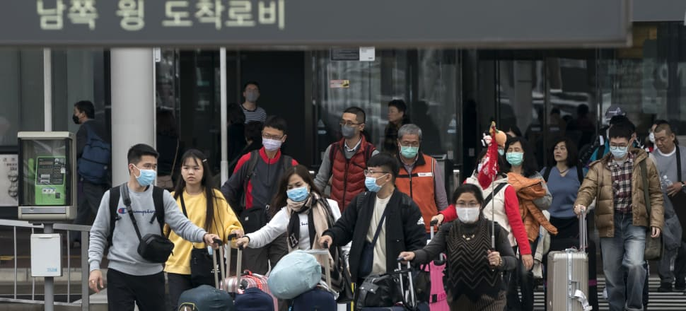 Chinese tourists arriving at Narita airport in Tokyo, Japan. Photo: Getty Images