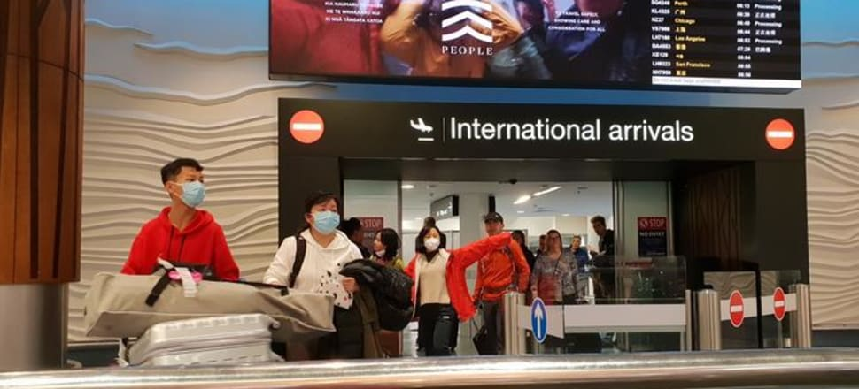 Passengers this morning at Auckland Airport, where flights from Guangzhou and Shanghai had touched down. Photo: RNZ / Liu Chen