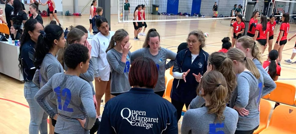 New Zealand youth men's volleyball coach Lee Turrell gives instruction to the young Queen Margaret College girls team she also coaches. Photo: supplied.