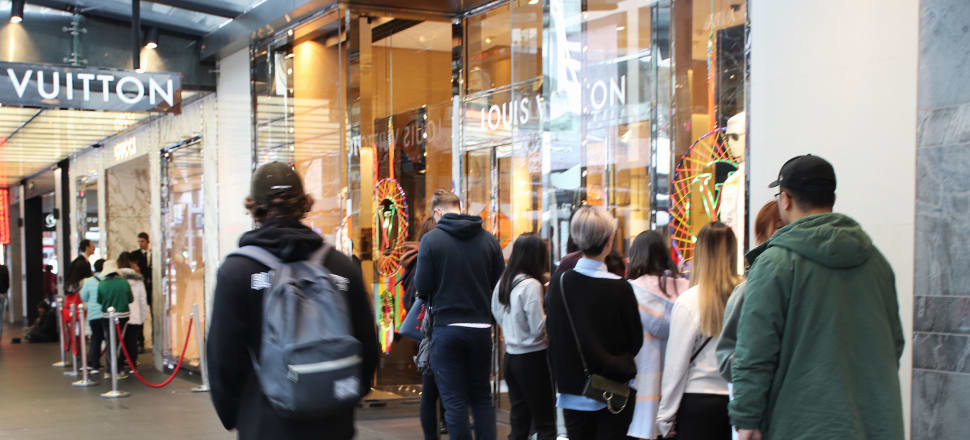 You might think it's easy to spot millionaires - perhaps the ones lining up to shop at Louis Vuitton - but just over 4 percent of New Zealanders are worth more than $1 million. Many of those hit by the Greens proposed tax changes would be surprised to learn that they are amongst the highest earning New Zealanders. Photo: Lynn Grieveson
