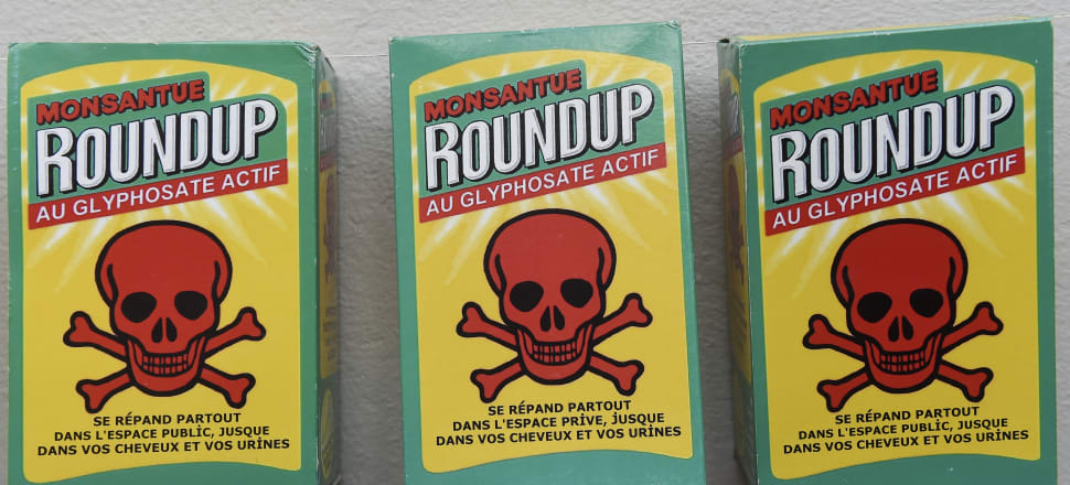 Fake RoundUp packets used in an anti-glyphosate protest in France. Photo: Getty Images