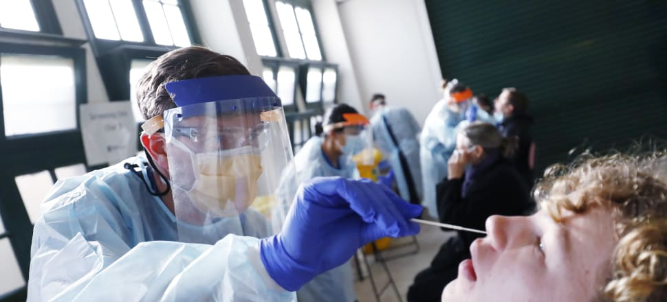 Members of the public are tested at a walk in COVID clinic in Brunswick in Melbourne following a spike in new coronavirus cases through community transmission. Photo: Getty