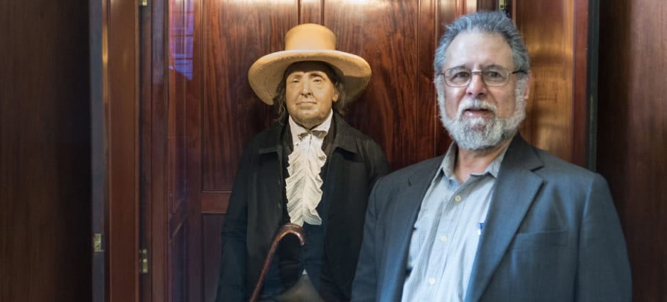 We cross live to David Tossman, pictured here with English philosopher Jeremy Bentham at University College, London: when Bentham died, his body was dissected in public, then stuffed and put on display in a wooden box.