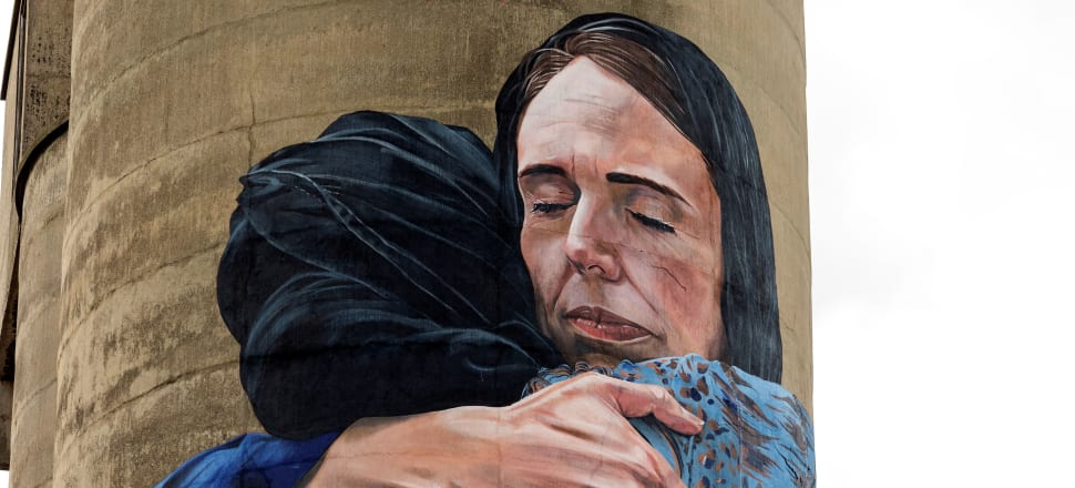 The image captured in the photo at the end this article of  Jacinda Ardern hugging an Islamic migrant in the wake of the Christchurch attacks has become an icon in centre-left circles. It was painted on a silo in Melbourne by Australian fans, citing her compassion. Photo: Getty Images
