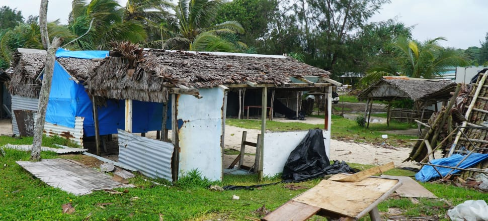 Badly damaged buildings are pictured near Vanuatu's capital of Port Vila after Tropical Cyclone Harold swept past and hit islands to the north. Photo: Getty Images.