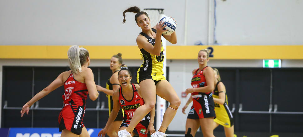 Karin Burger is airborne, taking a pass for the Pulse in their only ANZ Premiership match of the season so far, against the Tactix back in mid-March. Photo: Getty Images.