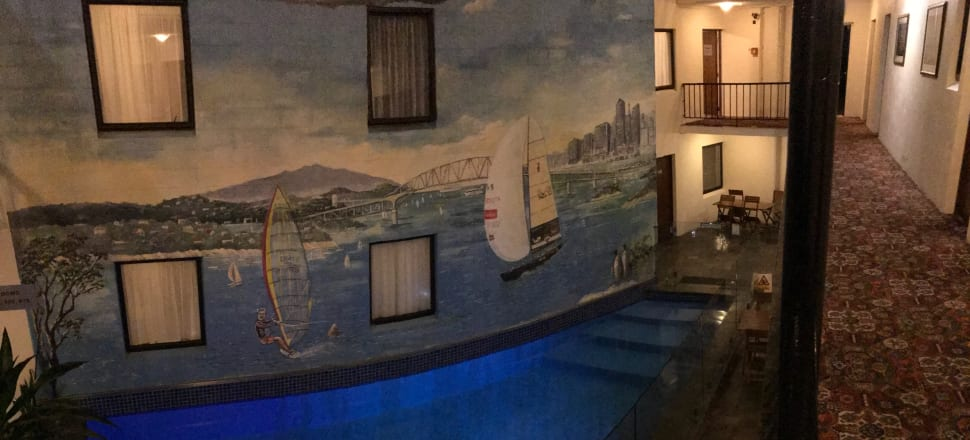 One of the world's most peculiar swimming pools: the indoor pool (with mural!) at the Surrey Hotel. Photo by Naomi Arnold.