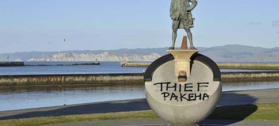 "Graffiti on the Gisborne statue of James Cook reading ""Thief Pakeha"". Photo: RNZ (Supplied)"
