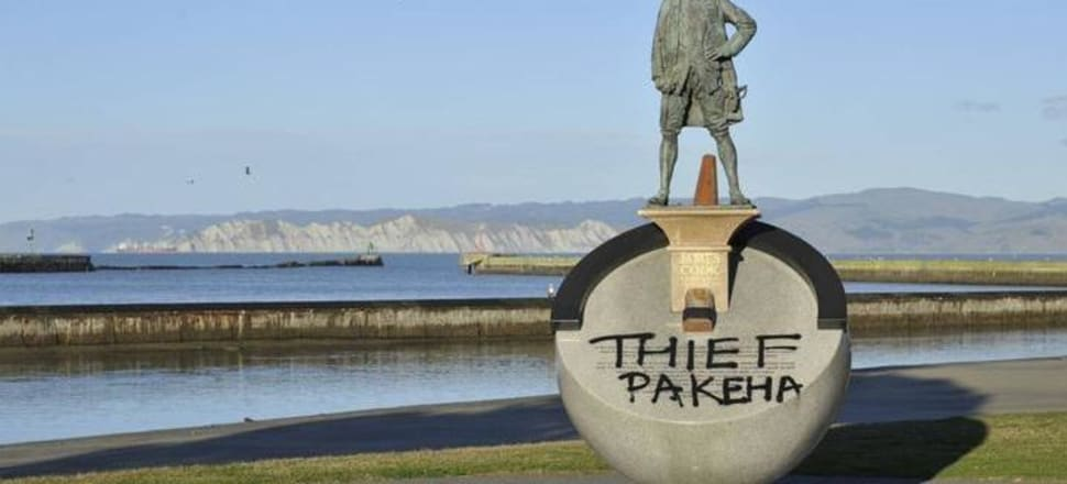 Graffiti on the Gisborne statue of James Cook reading 'Thief Pakeha'. We owe ourselves a considered and careful reappraisal of our public memorials, writes Felicity Barnes. Photo: RNZ/Supplied