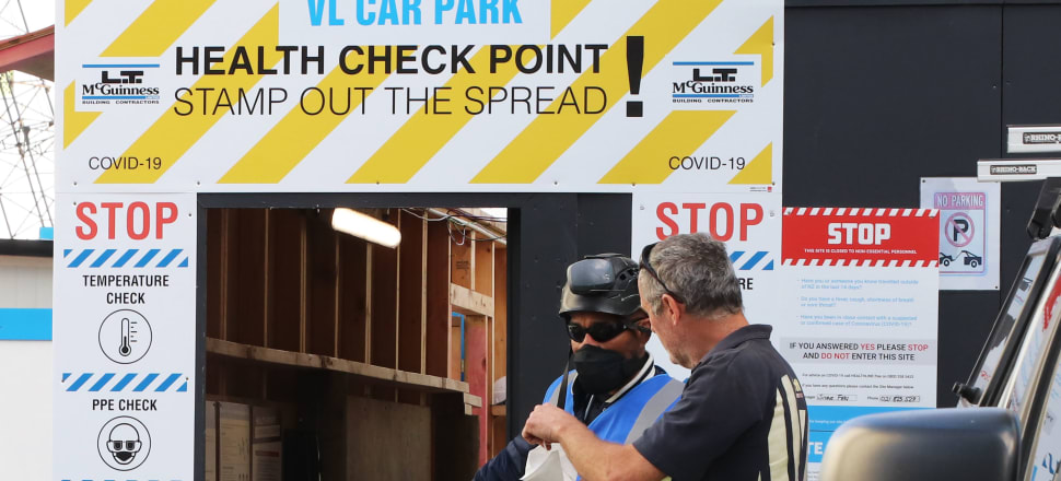 A Covid-19 health check point for construction workers as their site re-opens after lockdown. Construction was the biggest contributor to the drop in GDP, falling 4.1 percent as building sites were shut down. Photo: Lynn Grieveson