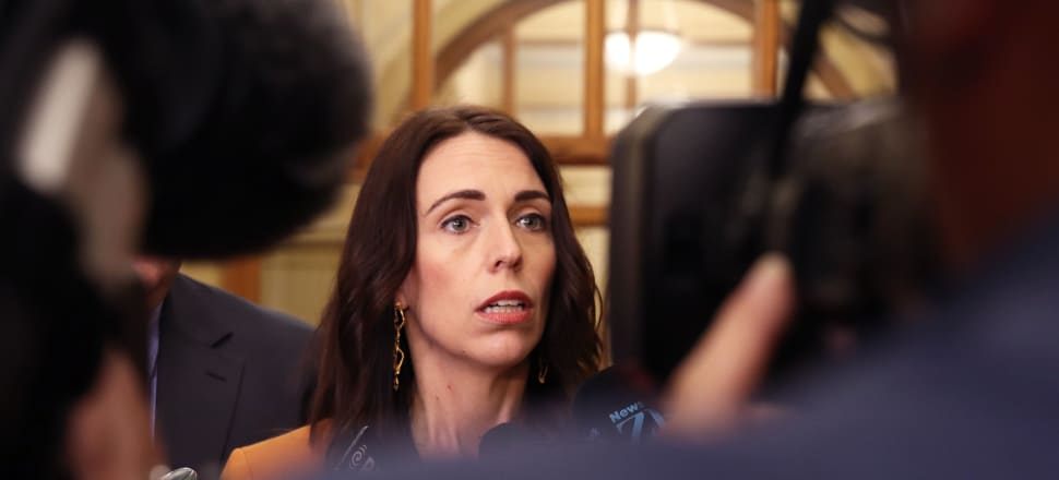 Jacinda Ardern in Parliament on Tuesday telling press gallery reporters that the Pasifika Festival and Christchurch memorial service will go ahead as planned. Photo: Lynn Grieveson