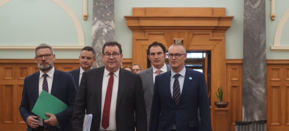 Finance Minister Grant Robertson is flanked by his colleagues as he prepares to announce the Government's economic response to the coronavirus pandemic. Photo: Sam Sachdeva.