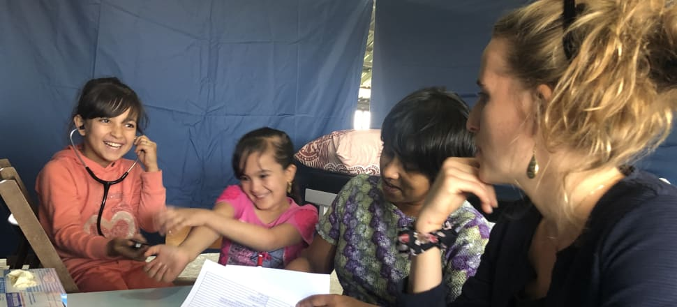 Himali McInnes working at a volunteer medical clinic  with Tearfund, in Lebanon's Beqaa valley, alongside Syrian refugees and Swedish translator Anna, in September 2019.
