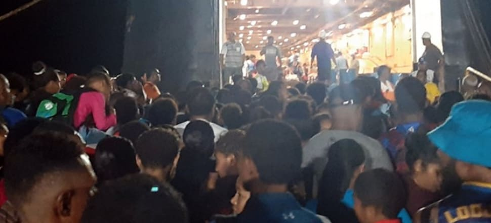 Crowds wait to board a ferry in Fiji, despite official urgings to keep physically distant. Photo: Shreeya Verma/Fiji Sun