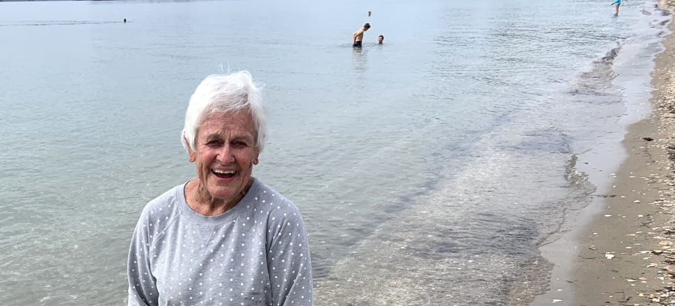 Jewele McLeod, 87, is one of a handful of swimmers who brave the waters off Auckland's Kohimarama Beach year-round - without wetsuits. Photo: Tim Murphy.