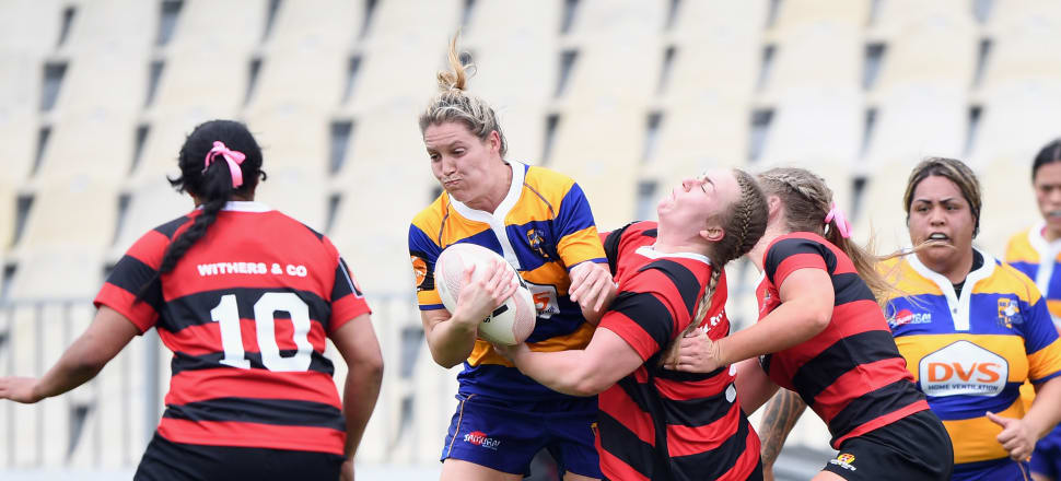 Bay of Plenty Volcanix lock, and former NZ volleyball star, Kelsie Wills tries to bust through a tackle during her first season in the Farah Palmer Cup last year. Photo: Getty Images.