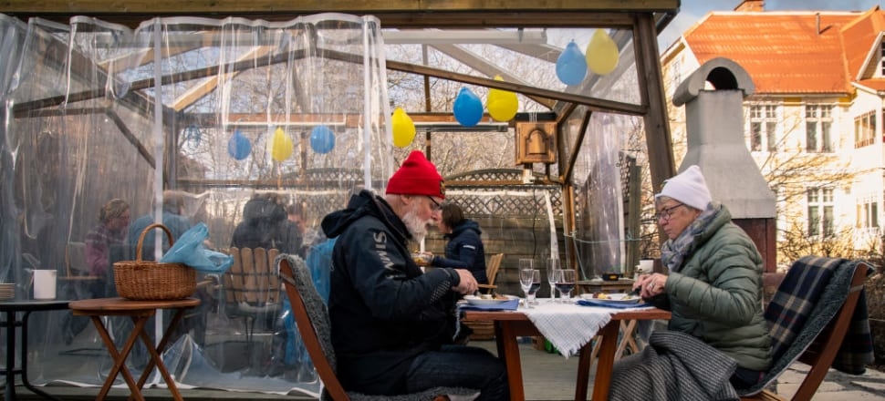 An elderly couple at an outdoor restaurant in Sweden, where Covid-19 came after several low mortality years which avoided the deaths of hundreds of elderly or vulnerable Swedes. Photo: Getty Images