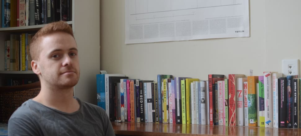 To mark the election campaign, we begin a new photographic series of journalists from the press gallery. This week: good old Henry Cooke, ace political reporter with Stuff, at his Wellington home. His bookshelf includes the work of Janet Malcolm, Hera Lindsay Bird, David Remnick, Pip Adam, Atul Guwande, and Sport 47 edited by Tayi Tibble. No clutter, everything tidily arranged.