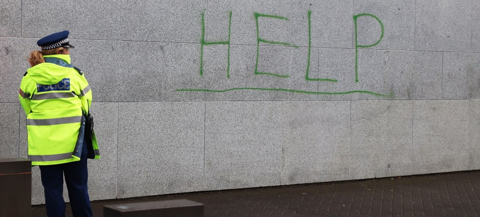 'Help' written on the Beehive wall on the day of a protest against uplifts of Maori children by Oranga Tamariki. Social work is increasingly about cost-effective discipline of the disadvantaged, writes Ian Hyslop. Photo: Lynn Grieveson