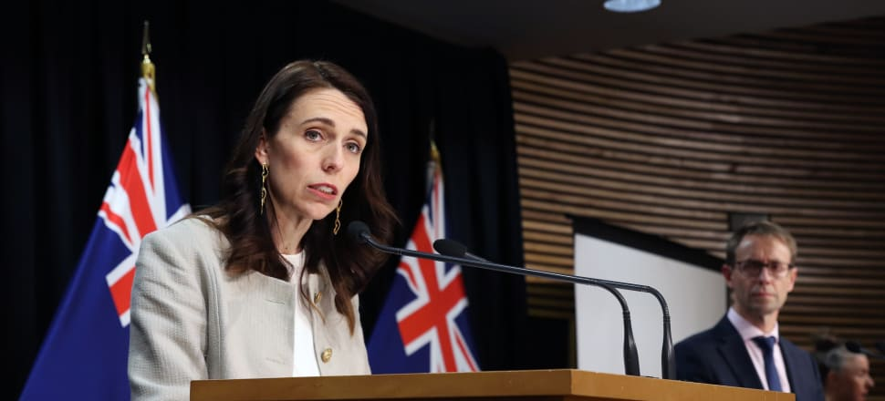 Jacinda Ardern and Ashley Bloomfield face the music. Photo: Lynn Grieveson